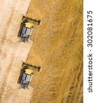Small photo of Aerial view of combine harvester on wheat field. Industrial background on agricultural theme.