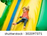 Joyful Little Girl Playing On ...