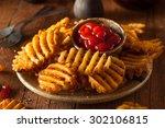 crispy homemade waffles fries... | Shutterstock . vector #302106815