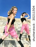 Beautiful modern dancers on the ancient stairs of  Kurion amphitheatre in Cyprus. - stock photo