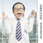 attractive little boy wearing a ... | Shutterstock . vector #302176865