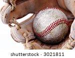 worn baseball and glove close-up - stock photo