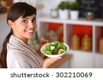 young woman eating fresh salad... | Shutterstock . vector #302210069