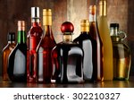 bottles of assorted alcoholic... | Shutterstock . vector #302210327