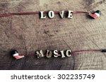 portable audio earphones on old ... | Shutterstock . vector #302235749