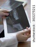 Doctor Examining An Elbow X Ray....