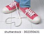 female feet in gum shoes on... | Shutterstock . vector #302350631