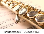 Silver Flute On Music Notes...