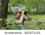 cute little boy playing with... | Shutterstock . vector #302371151