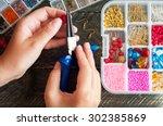 making of handmade jewellery....   Shutterstock . vector #302385869
