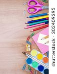 school and office supplies on a ... | Shutterstock . vector #302409395