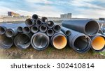 stacked pipes in construction... | Shutterstock . vector #302410814