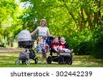 Young Mother Walking In A Park...