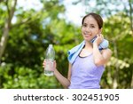 sporty woman hold with water... | Shutterstock . vector #302451905