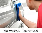 a man polishing car with... | Shutterstock . vector #302481905