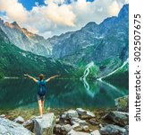 tourist woman near the mountain ... | Shutterstock . vector #302507675