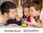Healthy Family Drinking Fresh...