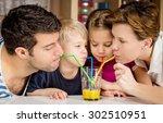 Healthy Family Drinking Fresh...
