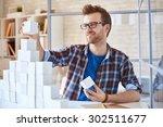 successful businessman building ... | Shutterstock . vector #302511677