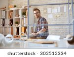 serious architect working with... | Shutterstock . vector #302512334