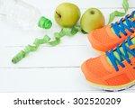 sport shoes  apple and bottle... | Shutterstock . vector #302520209