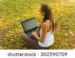 young woman using tablet ... | Shutterstock . vector #302590709