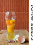 Raw Egg With Yellow Yolk In A...