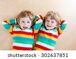 two little sibling kid boys... | Shutterstock . vector #302637851