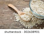 cup of dry rolled oat flakes... | Shutterstock . vector #302638901