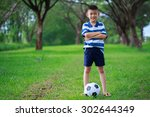 Asian Kid Standing With Soccer...