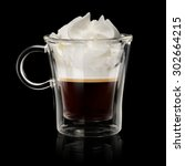 Coffee vienna (con panna) in transparent cup on black background - stock photo