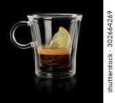 Coffee Espresso romano in transparent cup on black background - stock photo