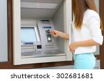 young woman inserting a credit...   Shutterstock . vector #302681681