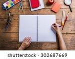 desk with school supplies.... | Shutterstock . vector #302687669