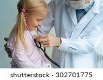 doctor examining little girl... | Shutterstock . vector #302701775