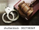 Gavel And Handcuffs With Red...