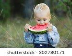 cute little boy eats big... | Shutterstock . vector #302780171