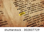 Small photo of Alibi word in old textured dictionary