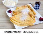 fresh crepes with jam and cream ...   Shutterstock . vector #302839811