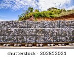 gabion wall made of stones in... | Shutterstock . vector #302852021