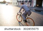 businessman riding bicycle to... | Shutterstock . vector #302855075