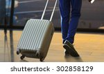 business man with suitcase in... | Shutterstock . vector #302858129