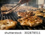 grilling  meat with barbecue...   Shutterstock . vector #302878511