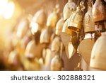 Many Golden Buddhist Bells Wit...