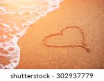 Heart Drawn In The Sand Of Sea...