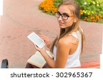 young woman using laptop...   Shutterstock . vector #302965367