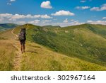 tourist with a large backpack... | Shutterstock . vector #302967164