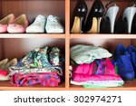 clothes neatly folded on shelves | Shutterstock . vector #302974271