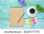blank notepad with macaroons...   Shutterstock . vector #302977775