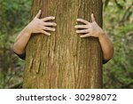 a person hugs the trunk of a... | Shutterstock . vector #30298072